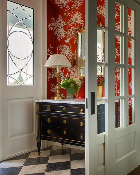 welcoming small entry with cheerful pop of red anchored with black