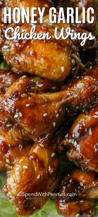 We cannot get enough of these Honey Garlic Chicken Wings! A sweet and slightly spicy sauce coats crisp chicken wings. And the best part is these wings are baked, not fried! #spendwithpennies #chickenwings #honeygarlic #bakedchickenwings #easyrecipe #easychickenwings #appetizer #chicken #withsauce #sweetandspicy #honeygarlicwings