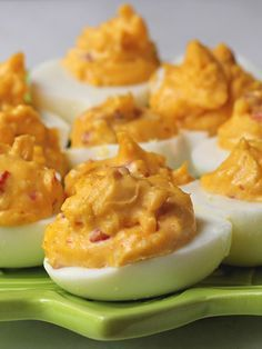 Pimento Cheese Stuffed Eggs --- Delicious and different deviled eggs - folks will be begging for this recipe with pimento cheese mixed into the yolks.