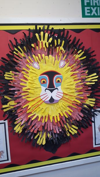 Why does Lion Roar? Tinga Tinga tales. Y5 class handprints used to make the lions mane.