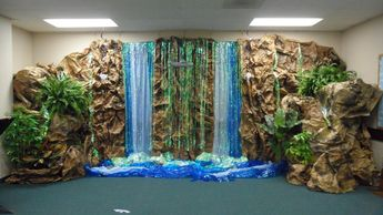 """finished falls w/more """"rocky"""" walls and greenery. Storage & file cabinets of classroom become foundation for rock walls & cliffs on both sides of falls"""