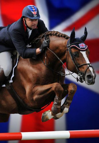 Incredible shot! Look at the intensity on their faces...awesome! #horsejumping