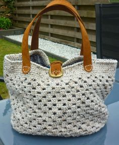 Granny stitch purse with leather handles.