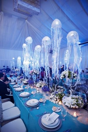 under the sea wedding motif with hanging jellyfish table decorations - great aquarium wedding idea