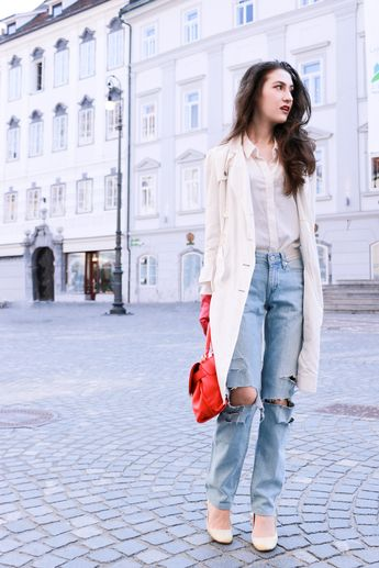955d85769b04 Fashion blogger Veronika Lipar of Brunette From Wall Street sharing how to  style light blue ripped