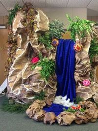 Journey off the Map, VBS 2015, waterfall..... Made from cardboard boxes, a roll of brown construction paper from Lowes, some paint, sparkly blue fabrics that I got at Hancocks, white polyfill at the bottom of the waterfall, rocks made from paper sacks stuffed, greenery from the church' slower room, and a few tissue flowers