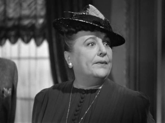 """Wretched stuff! Give me a chocolate, quick!""    Florence Bates, Rebecca. 1940."