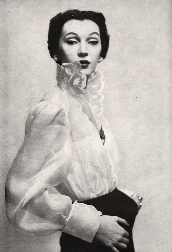 Dovima, Vogue magazine, march 15 1950 Gregory organdie shirt, photo Clifford Coffin. Image via Pinterest.