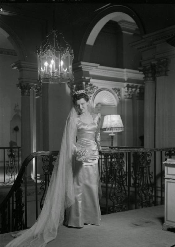 Photo by the Ministry of Information. Peggy Bryan models the wedding dress designed for her by fashion designer Bianca Mosca. The dress is to be worn by Peggy in the new British horror film 'Dead of Night'. Image via Pinterest.