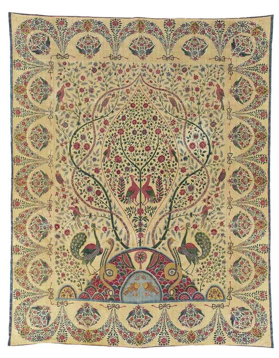 A PALAMPORE COROMANDEL COAST, SOUTH INDIA, SECOND QUARTER 19TH CENTURY The block-printed and dyed decoration consisting of a central tree within ovoid medallions, flanked by cobras and peacocks, the border a continuous floral garland, small inventory or shipping stamp to a corner 116 ½ x 91in. (296 x 231cm.