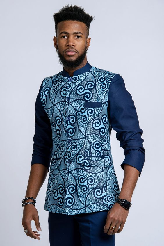 This design of African blazer for men is called Abacost. Created by President MObutu in 1972, it is a mixture of western suit and shirt.  Get a unique style with Afrilege's Abacost. More designs at afrilege.com