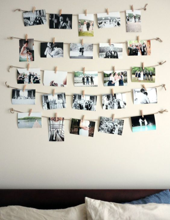 Clothes pin pictures. Cute, cheap way to displays all of our wedding photos~