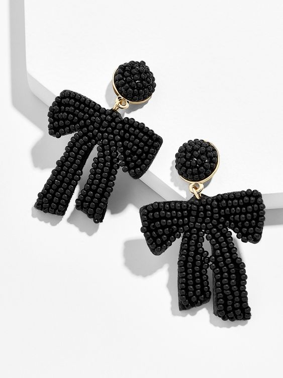 Add a pop of playful femininity to your lobes with this decidedly chic pair. A monochrome hue combines with a lustrous palette and a sultry swath of seed beads to lend immediate oomph to everything already in your wardrobe. Trust us, this is the pair we just know you'll reach for again and again.