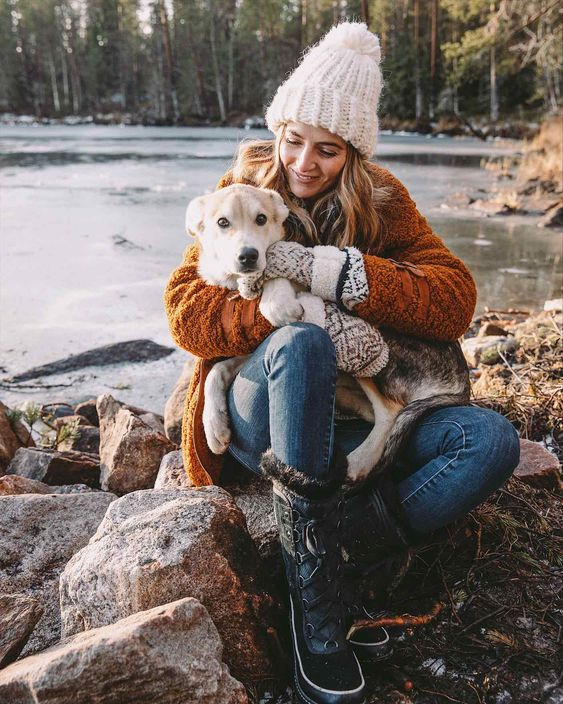 Jess Ann Kirby visits snow puppies while on a trip to Finland