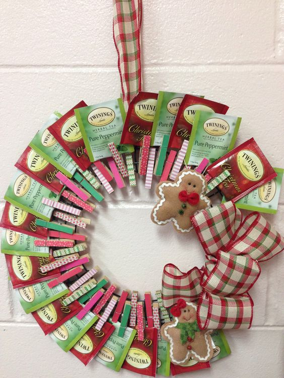 DIY tea wreath. Materials: wreath frame (I found a wire frame in the floral dept. of Michaels), clothespins (check the scrapbook aisle or create your own with paint or washi tape), glue dots or hot glue, festive ribbon, and your favorite brand of tea. Makes a great gift for a tea-lover and can be reused as a photo or card holder.
