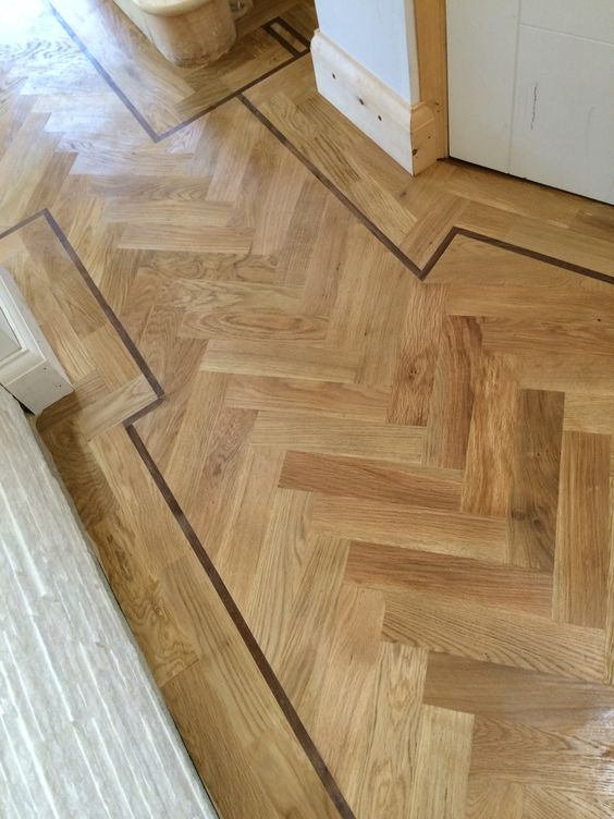 Oak parquet with a detail tramline in Walnut, sanded and seaed.