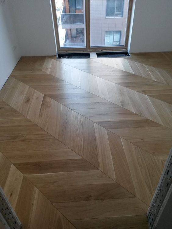 Oak Natural. Engineered wood chevron parquet flooring blocks. Small bedroom and large open spaces - chevron always looks fab!!!   Chevron parquet delivery worldwide. #chevronparquet #engineeredwoodfloors #woodenfloors #parquetUK #parquetflooringUK