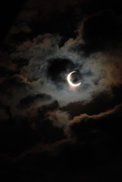 Beautiful crescent moon with surrounding clouds.
