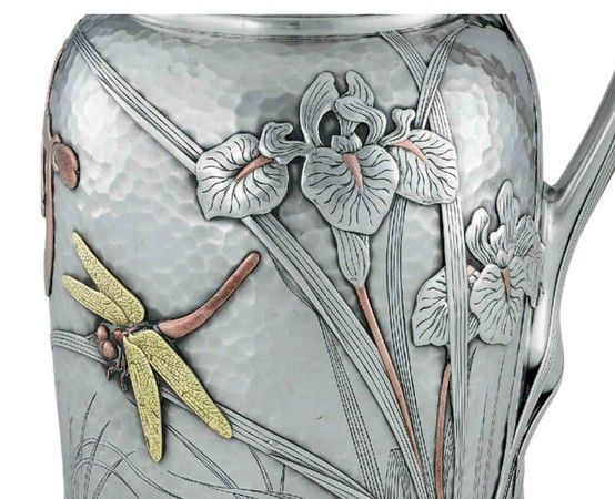 A FINE SILVER AND MIXED-METAL WATER PITCHER  MARK OF TIFFANY & CO., NEW YORK, CIRCA 1880