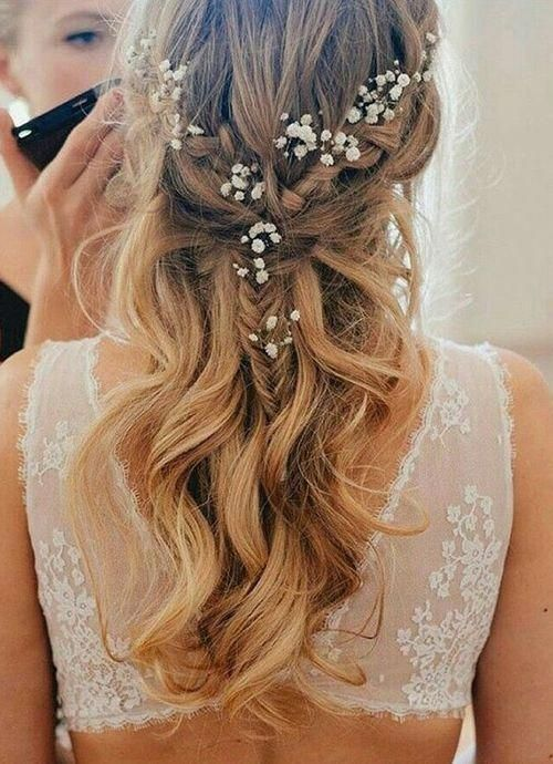 10 Pretty Braided Wedding Hairstyles: #5. Fishtail Half Up Half Down Hairstyle with Flowers #beautifulweddinghairstyles