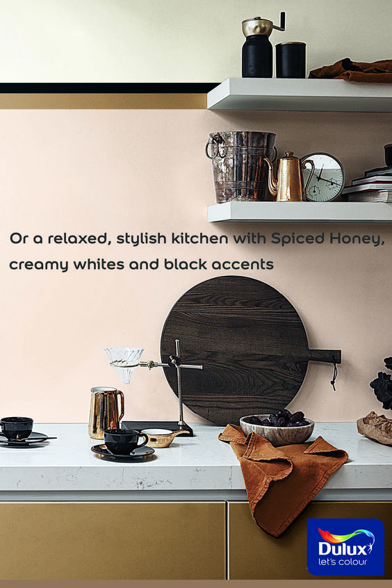 Dulux Spiced Honey, Colour of the Year 2019 creates a relaxed and stylish kitchen with creamy whites and black accents. Click here to see how else #SpicedHoney can be used in your kitchen. #KitchenDecor #kitchenIdeas