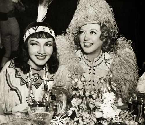 Marion outfeathering Claudette Colbert