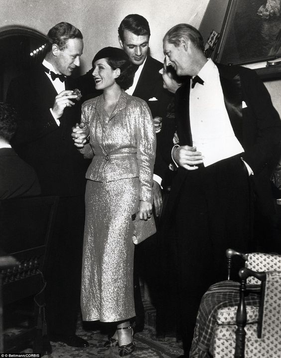 Thespian's retreat: Actors Leslie Howard, Norma Shearer, Gary Cooper and Lionel Barrymore (left to right) are seen here during the Christmas Eve party given by Cooper at his home in Hollywood in 1932
