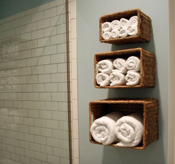 Hang baskets in the bathroom to store towels. #baskets #bathroom #store #towels