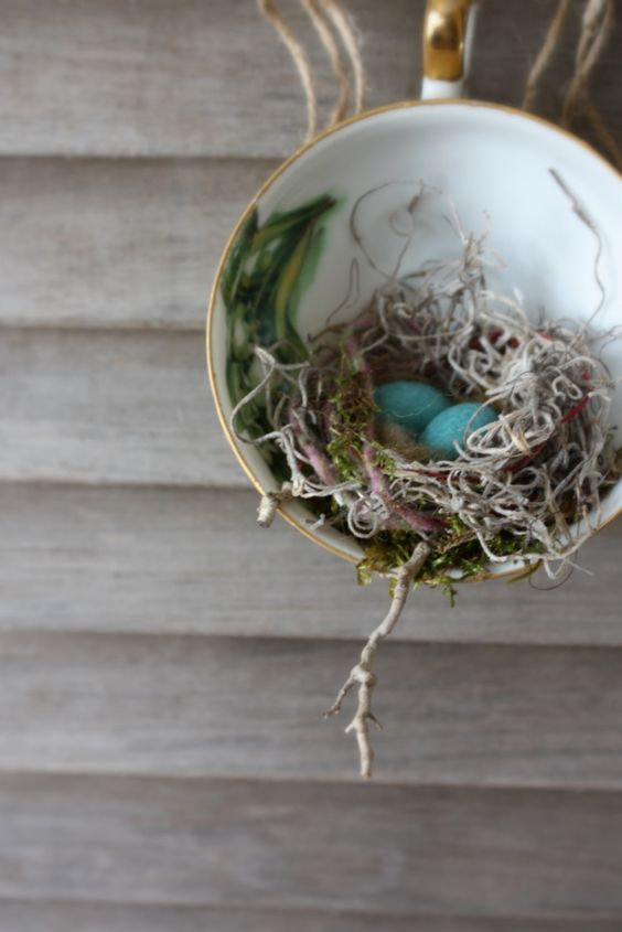 I love making these. Little nests made of tidbits of moss, yarn, and twigs with wool eggs are nestled into a vintage tea cup. Photographed against my side-of-the-road free wooden shutters. They were taken off of a 1920s farm house that was being remodeled. I grabbed a couple.