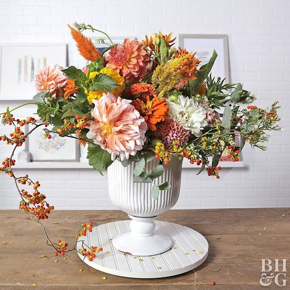 Do something more with your favorite varieties of dahlias, mums, and thistles. Use your favorite fall flowers to create a colorful autumn arrangement to celebrate the season. #floralarrangement #fallflowers