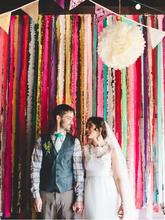 colorful crepe paper, paper banners, paper pompoms for backdrop