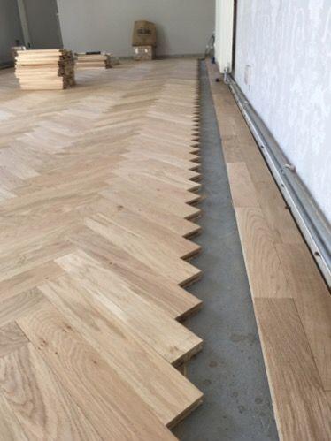Oak parquet in a Herringbone pattern.