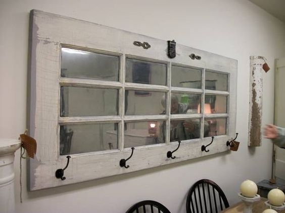 Repurposed door into mirror/coatrack