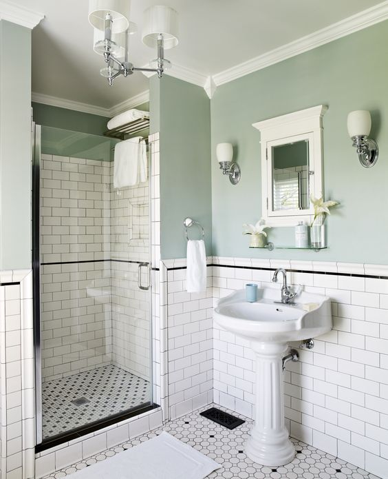 One of the last rooms to be renovated was the first-floor bath, which was a 1950s addition to the original structure. A sinking foundation meant that the room had to be rebuilt from the ground up. Amy estimates that Karl installed 2,000 tiles in this bathroom, but the couple kept costs affordable by using basics sourced from their local home center.