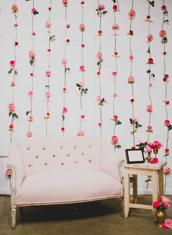 Repurpose leftover flowers from Valentine's Day into hanging fresh flower wall decor.