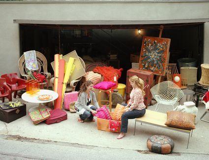 women talking with furniture around them