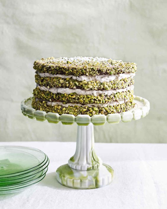 pistachio cannoli cake :: This dramatic four-layer cake is inspired by the flavors of Sicilian-style cannoli, which is stuffed with ricotta, chopped chocolate, and ca