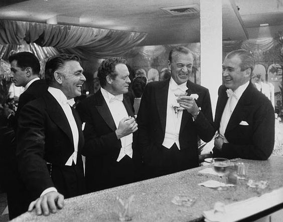 Premium Rates Apply. Film stars (left to right) Clark Gable (1901 - 1960), Van Heflin (1910 - 1971), Gary Cooper (1901 - 1961) and James Stewart (1908 - 1997) enjoy a joke at a New Year's party held at Romanoff's in Beverly Hills. Original Publication: A Wonderful Time - Slim Aarons  (Photo by Slim Aarons/Getty Images)