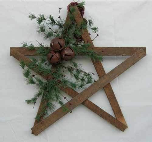 ≈ weathered wooden slat star - rusted jingle bells - airy greenery - some red berries wouldn't be out of place - rustic Christmas decoration - star wreath