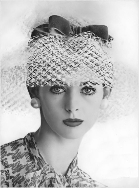 "Former model turned actress, Millie Perkins, star of ""The Diary of Anne Frank"", is wearing a veiled brimmed hat by Sally Victor, photo by Jerry Schatzberg, Vogue, July 1959"