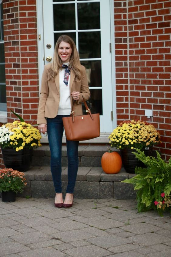 white sweater with navy scarf, camel blazer, Old Navy Rockstar jeans, Tory Burch cognac tote, burgundy pumps