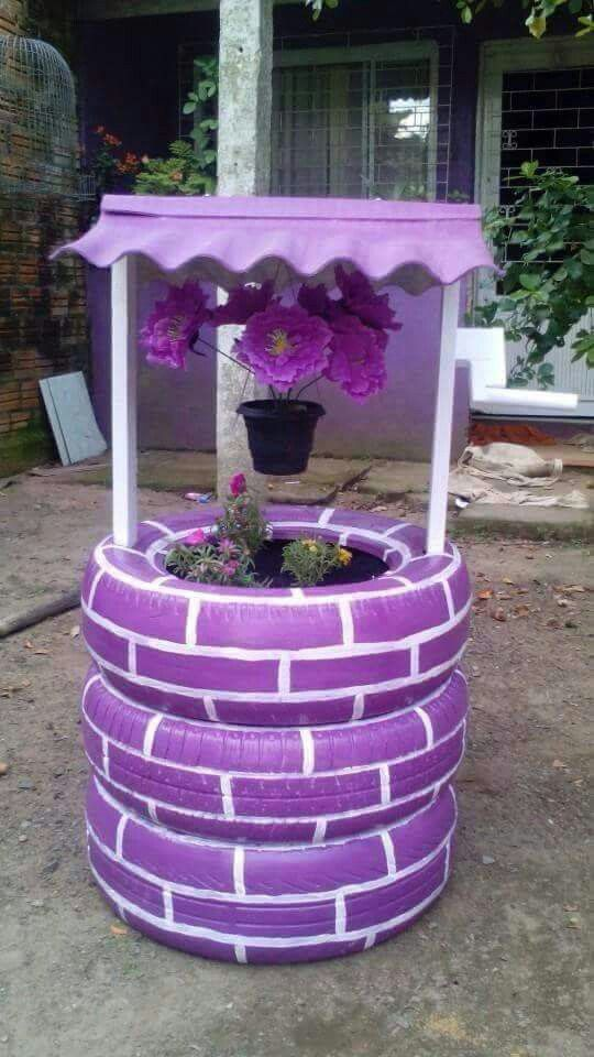 The Chic Technique: Recycle old tires by making this cute purple and white wishing well.
