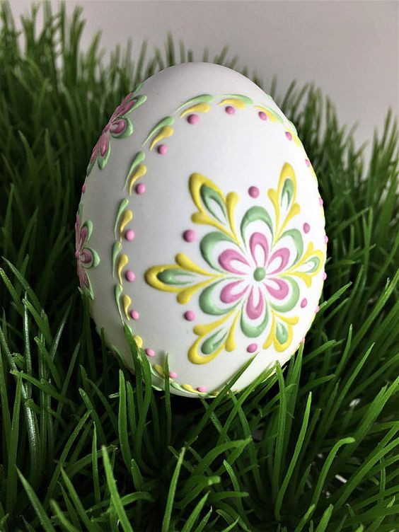 This is a very small duck egg (medium chicken size egg) in its natural white color. It is decorated in soft green, yellow, and pink wax. To create this egg, I used the pinhead method also known as the drop-and-pull pinhead method. In this method of making pysanky, mostly used in Poland, the Czech Republic, Slovenia, and Lithuania, a pin stylus is used as a tool. The head of the pin is dipped into hot wax and applied to the eggshell. There are two basic techniques used in this method: wax-embo...