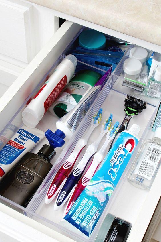 Organized bathroom drawer using an acrylic drawer divider tray.