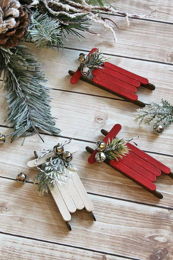 Rustic popsicle stick Christmas ornaments. Perfect for hanging on the tree, using as cute gift toppers, or for use in a pretty Christmas vignette. Fun Christmas craft to do with the kids as well!