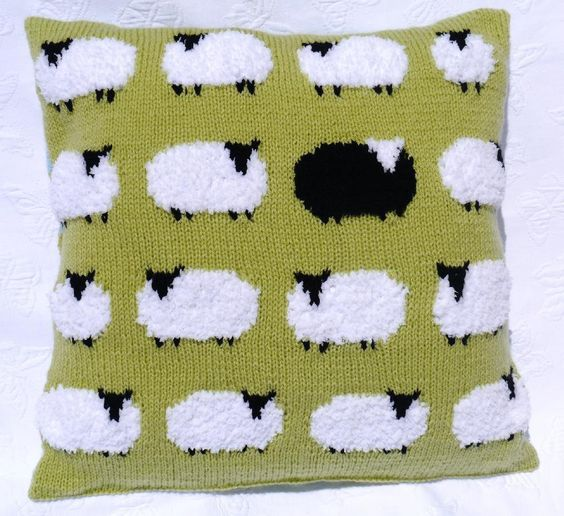 A very stylish cushion featuring white fluffy sheep and one black sheep.The cushion is knitted in one piece. The back has a button opening and is knitted in stripes of 5 rows per colour. Add some lovely sheep buttons to add interest to the back of the cushion.If you already have Double Knitting yarns in similar colours they could be used as long as they match the gauge 22 sts and 28 rows to 4
