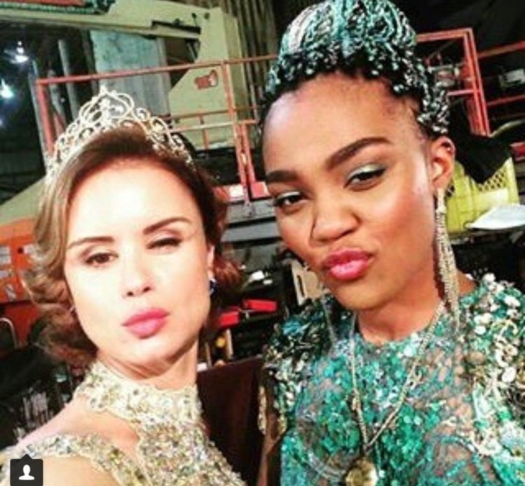 Uma and Queen Belle behind the scenes