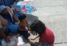 Watch 9-Year-old Rush to Take Off His Shoes So He Can Give Them to a Homeless Boy on the Street